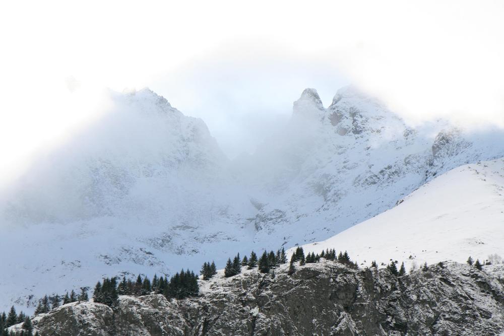 An extraordinary blue light through the clouds, Ecrins Massif