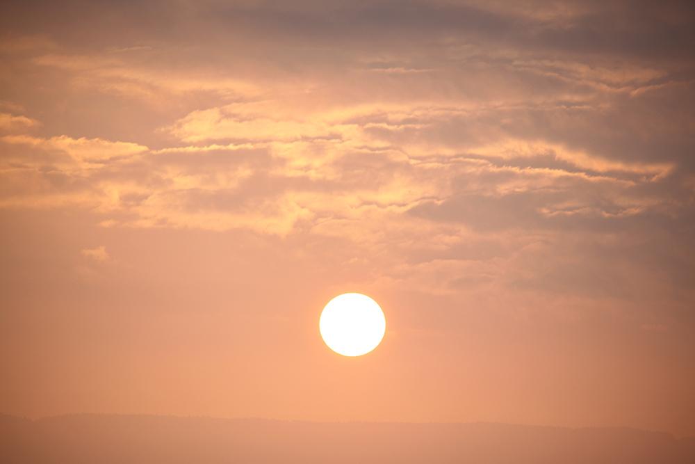 Sunset... No, rise above Geneva.